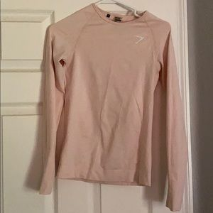 Gymshark pink long sleeve seamless workout top.